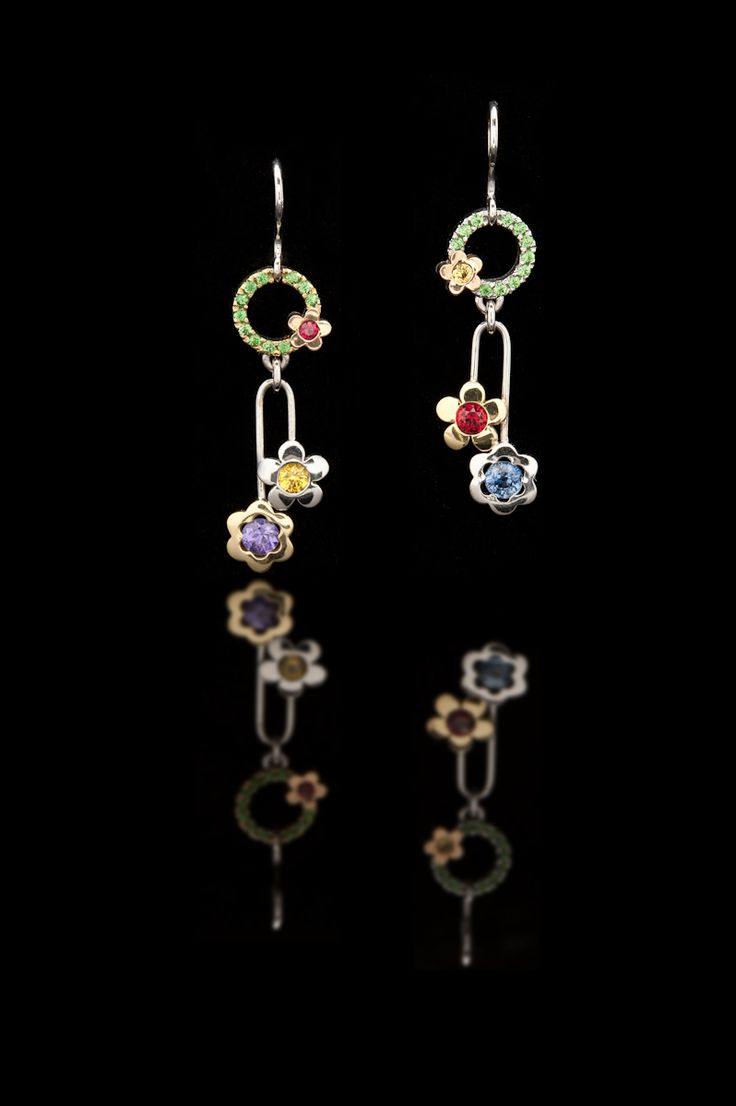 These gorgeous Flower earrings are made in 18ct gold and set with tsavorites, blue, yellow and purple sapphires and rubies. Or you can select your own colour combination.
