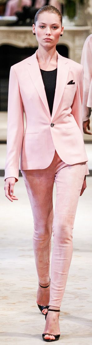 This is very inappropriate, for one, her pants are too tight. You want fitting with a little room. Next, shoes are inappropriate and lastly this pink color may be a little much for an interview.