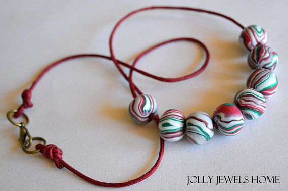 This necklace is handmade from polymer clay (FIMO), combining red, black, white and green colours, handforming it into a beautiful small striped beads. The item is one of a kind, handcrafted and handshaped, therefore, you will never find a second one like this! Wear unique - be unique! Wear this hippie style necklace for everyday, a special occasion or make it a gift to your loved one...  For a nice finish and protection, every bead is finished with semi-gloss varnish (FIMO). The beads are…