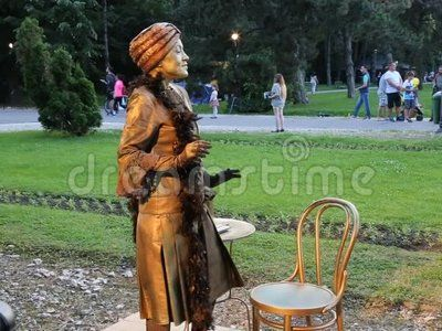 Young woman trying to sell her charm at international festival of living statues in Bucharest, Romania.