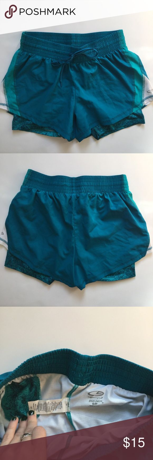 Champion Duo Dry Shorts Size small, perfect condition!  Teal, turquoise, and white. 2 layers--bottom is tighter spandex, top is lighter. Both layers are breathable!  Small pocket in the back!  Honestly, I SWEAR BY THESE SHORTS!  For anyone who wants a more secure feel without the restriction, these are the shorts for you! Champion Shorts