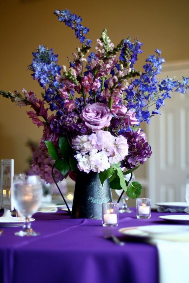 Purple hydrangea roses snapdragon and lilacs in rustic