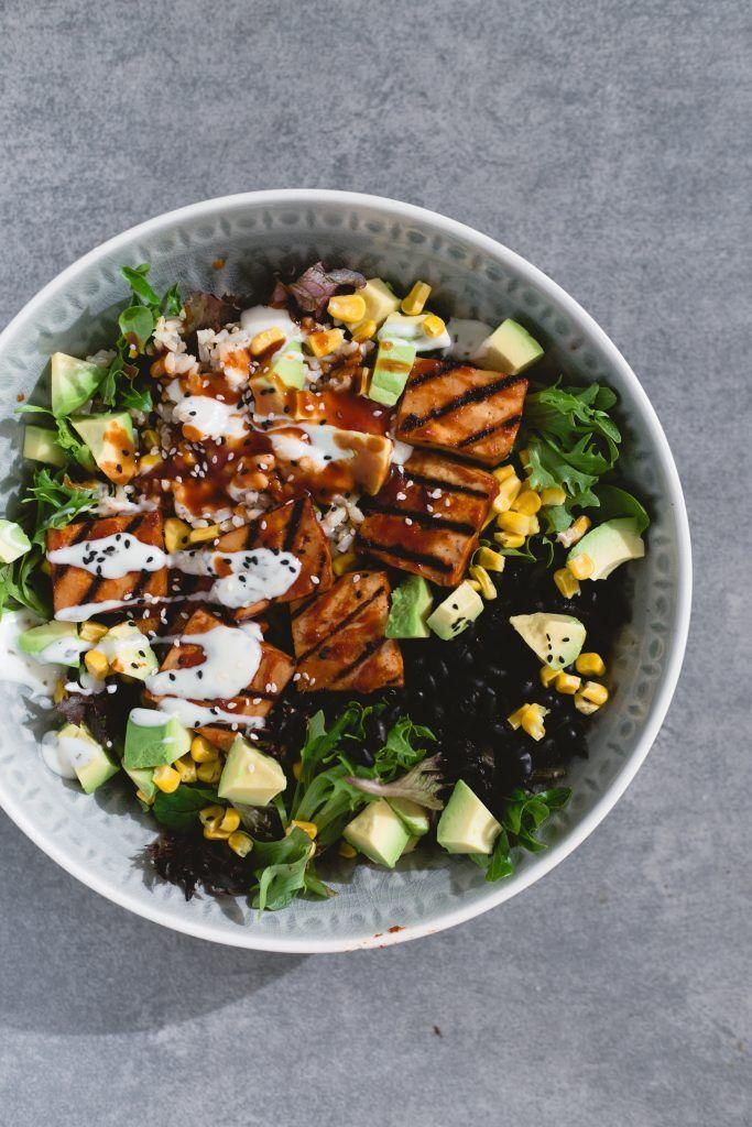 A delicious Vegan Barbecue Bowl loaded with Brown Rice, Avocado, Corn, Black Bea…