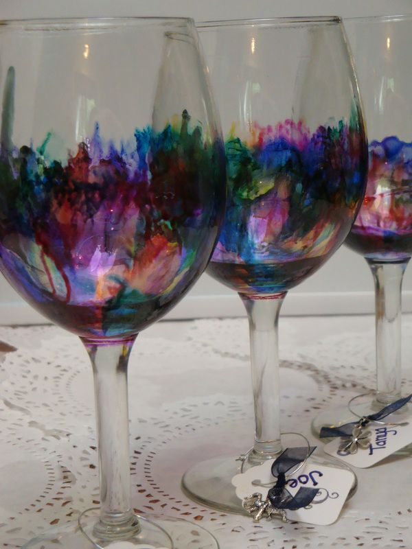 curiouserandcuriouser.org Awesome alcohol ink wine glasses sealed with spray Modge Podge. Picture