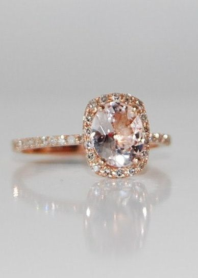 Love the color Peach Champagne Sapphire Ring. Only time I'll ever like pink is if it's on a beautiful ring like this.