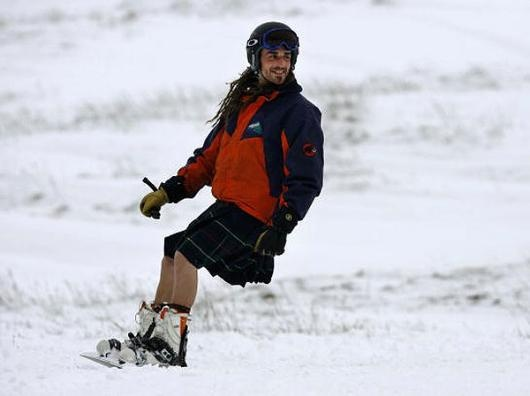 A snowboarder in a kilt on the slopes at the Nevis Range in Fort William, Scotland. - Jeff J Mitchell/Getty Images
