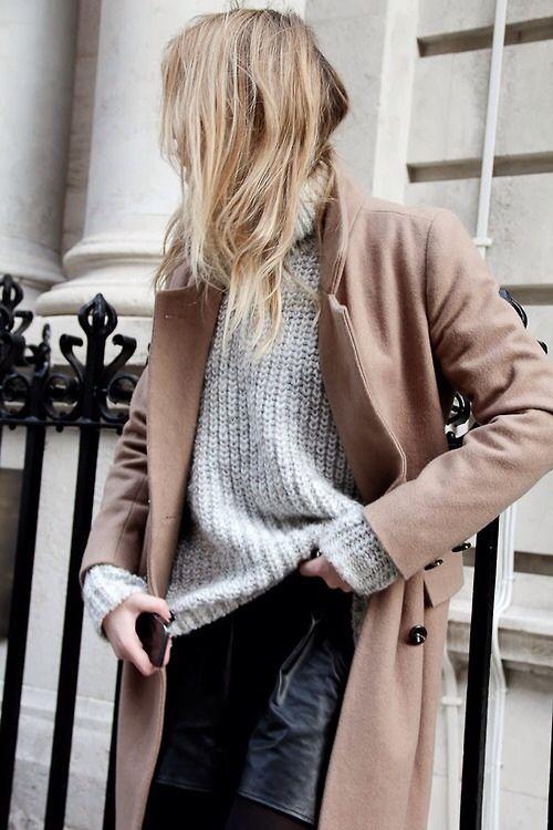 camel coat, grey oversized sweater, black leather-look shorts