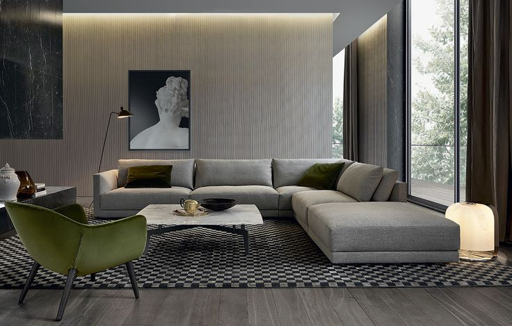 Bristol Jean-Marie Massaud (2013) Soft and comfortable shapes, the wraparound double backrest cushions and the thin armrests are the main features of Bristol, designed by Jean-Marie Massaud. This sofa allows to combine highly original layouts.