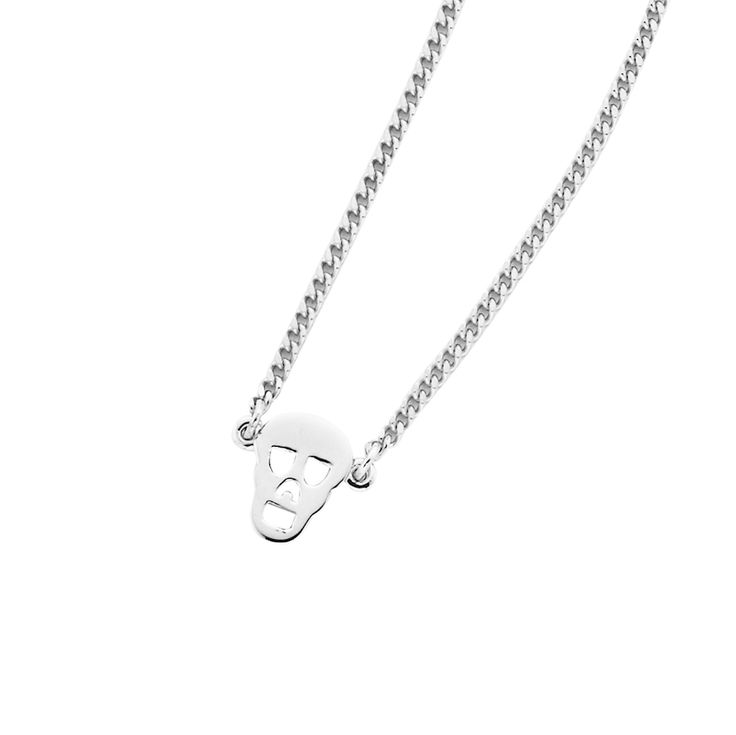 Mini Skull necklace - $Short, fine and delicate chain necklace crafted in 925 sterling silver, with a small feature mini skull charm detail, plus a KW and 925 embossed disc. Lovingly created by New Zealand clothing and accessories designer label Karen Walker. www.savethelastpinker.com.au/shop/mini-skull-necklace/
