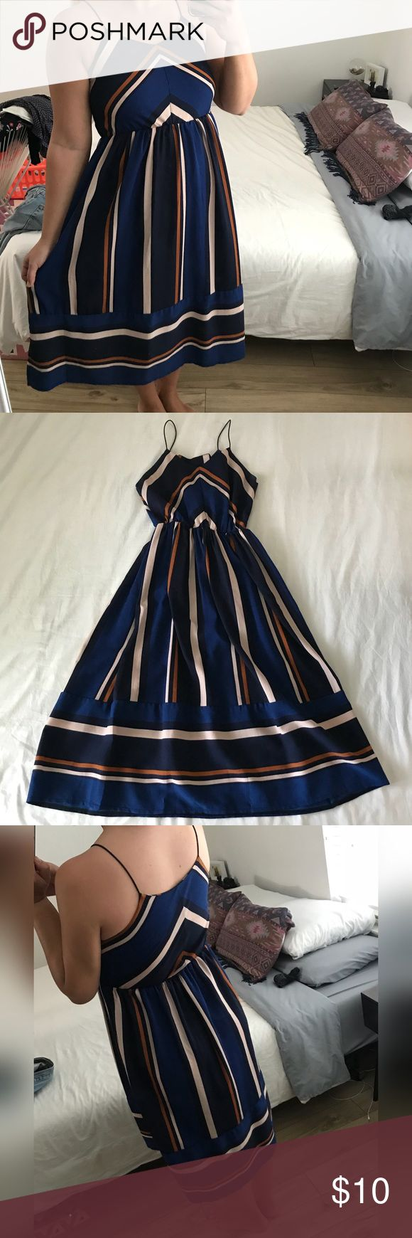 """Navy Blue Striped Dress Supposed to be a dupe for the Free People Bloom Dress . Definitely need to wear a slip with this dress . I really like that the material doesn't wrinkle and it drapes so nicely ! I'm 5' 5"""" and this goes to my mid calf . Dresses Midi"""