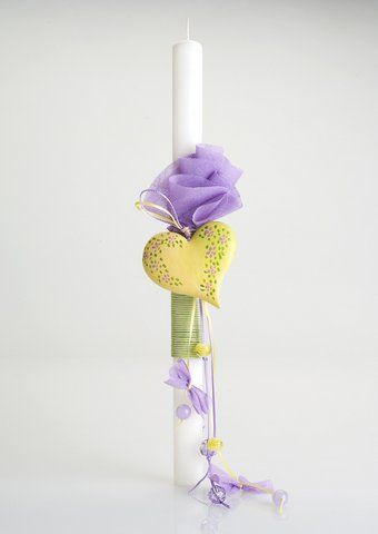 Handmade Easter candle with hand-painted ceramic item..