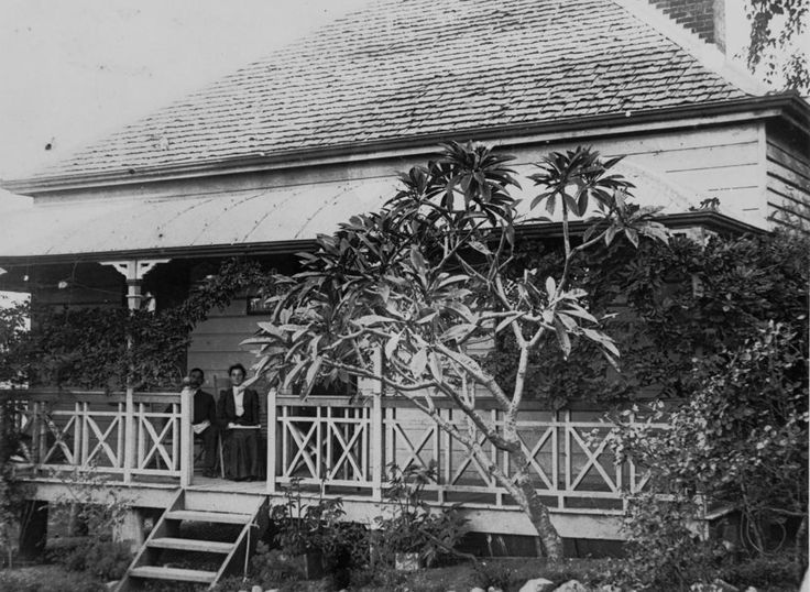 Sitting on the verandah in Woolloongabba, Brisbane, ca. 1905 - Shingle roofed house, possibly belonged to T. Ware in Heaslop Street, Woolloongabba.