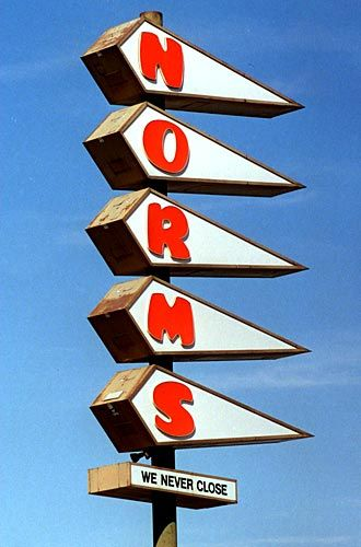 Norms had many features that came to typify the whimsical style of architecture known as Googie -- a vaulted roof that resembles a flying wing, a room-length dining counter and an attention-grabbing vertical neon sign with roots in Las Vegas kitsch.