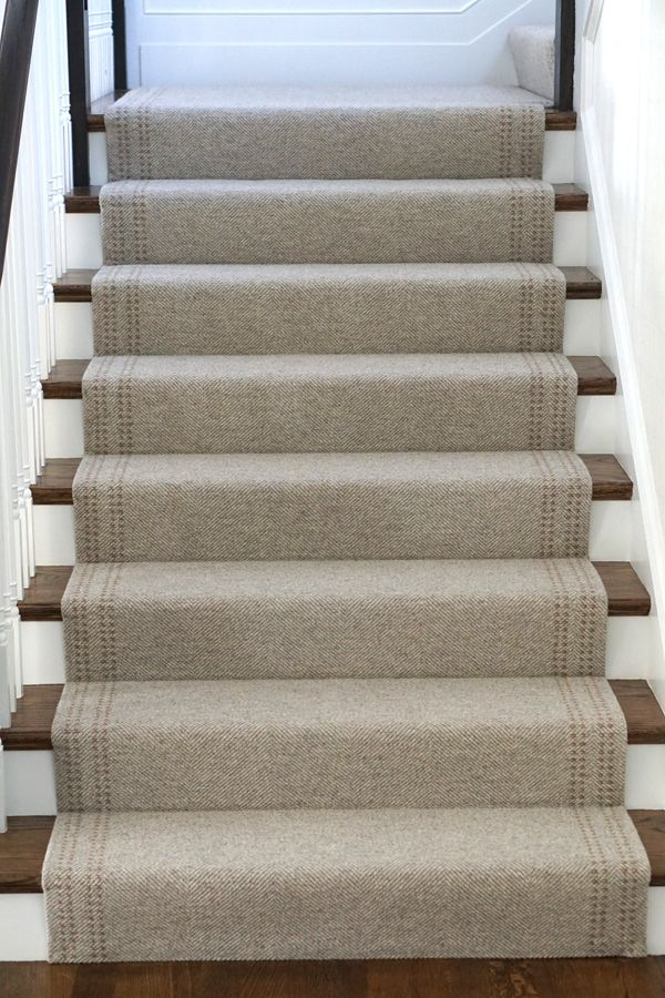 When scheming a project, the staircase may not be top of mind as an area to get creative. At Merida, we think there are endless opportunities to make a staircase shine with a well thought out runner expertly installed. Here are five ways to use a wool stair runner to make a statement.  1. Custom details specific to a staircase   Choose or customize a rug with details that compliment the staircase form and shape. A little detail goes a long way, as can be seen in this custom Harris wool rug…