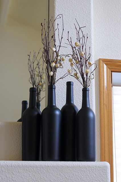 What to do with empty wine bottles? These are covered in chalk board paint