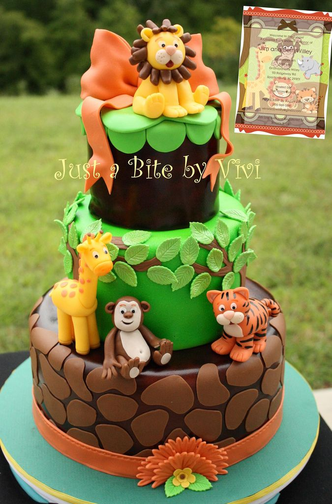 JUNGLE BABY SHOWER  Such a cute invitation , that has the theme for the nursery also, was used for inspiration for this cake. No sketch, I started working on it and mixing colors as I went. The monkey face looks almost too human yet.... :(  www.facebook.com/viviscakes