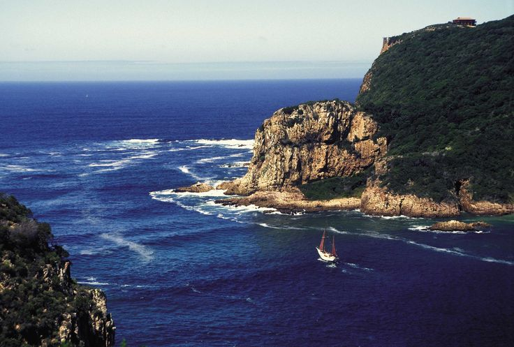 Yacht sailing through Knysna Heads
