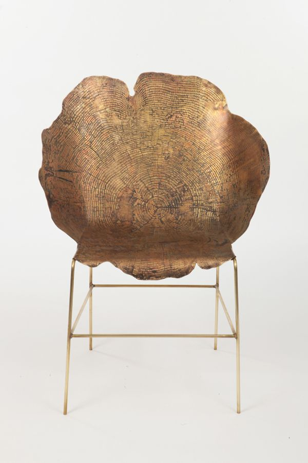 Beautiful metal chair with tree stump rest