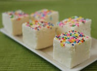 Cake Batter Fudge is a smooth, creamy fudge with the unmistakable flavor of cake batter! This fudge looks innocent, but one taste will bring you back to the days of licking cake batter off beaters. Top this fudge with a scattering of sprinkles to complete the resemblance.