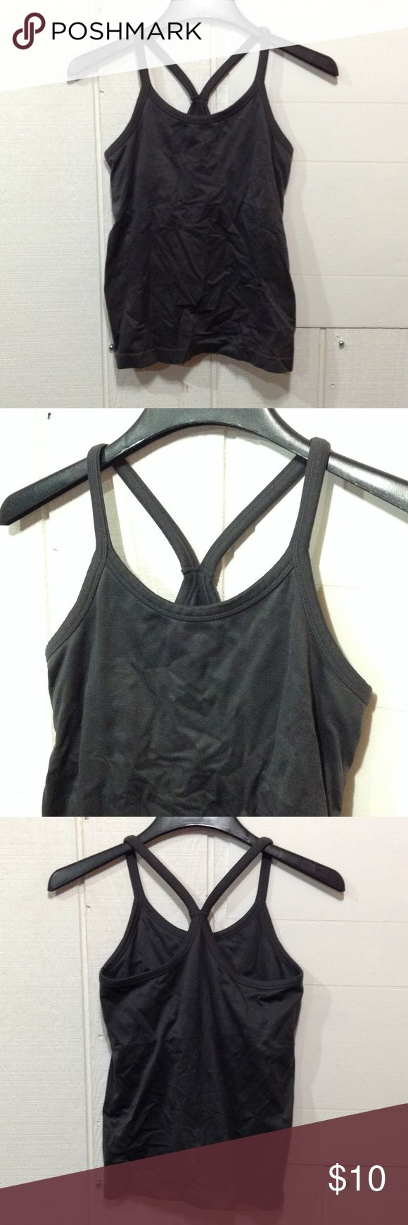 "Gray Athletic Tank Gray. Athletic tank. In good condition! Built-in sports bra. Brand and size unknown. Fits like a medium. Measurements Middle of neckline to bottom: 17"". Top of strap to very bottom: 23"". Tops Tank Tops"