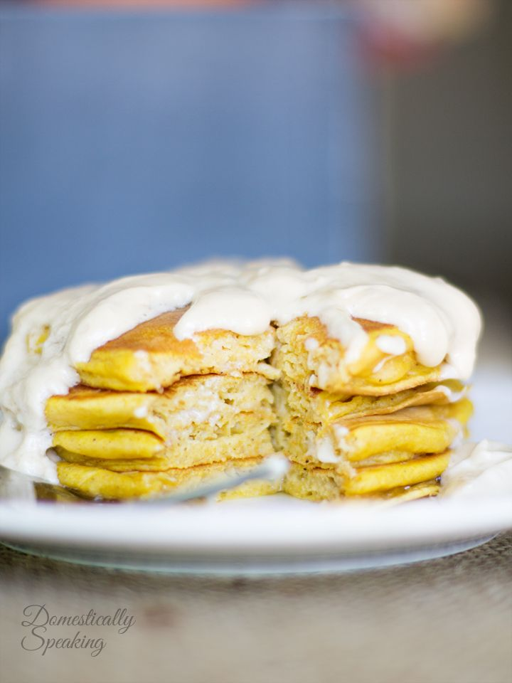 Pumpkin Spice Pancakes with Cream Cheese Maple Icing is the ultimate comfort food for breakfast! It's amazing with Greek yogurt the spices of the season.