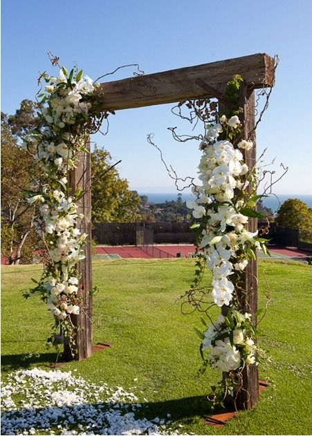 Floral Arch, jasmine and honeysuckle vines adorned with roses, hydrangea, orchids and lilies. Wonderful Wedding Idea