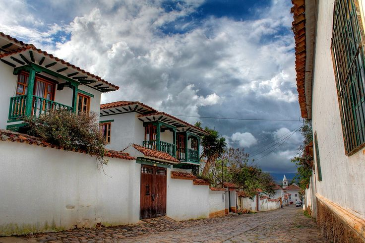 Colonial Villa de Leyva (Colombia). 'Big, wide-eyed blue skies hover over the high-altitude valley that forms  the backdrop of the impressive Villa de Leyva. Just 165km north of Bogotá, Villa is a sleepy, colonial village, with one of the largest and prettiest main squares in the Americas. Lazy Villa and its picturesque center are flush with gastronomic pleasures, rich history, churches, museums and artisan shopping.' http://www.lonelyplanet.com/colombia/north-of-bogota/villa-de-leyva