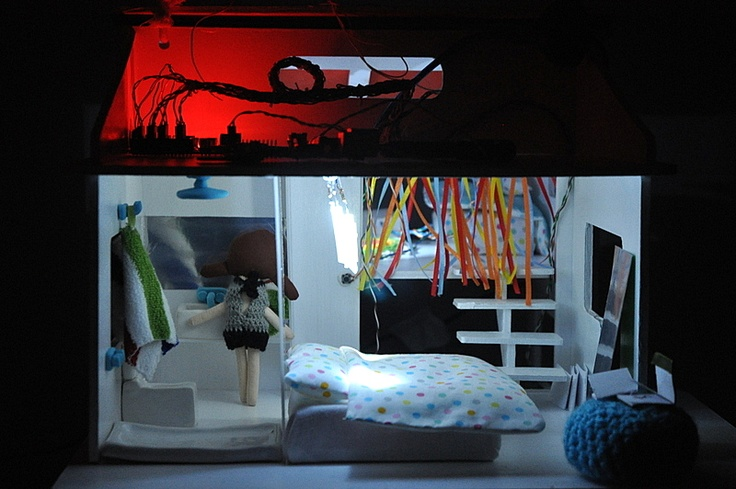 lights in a doll house at night