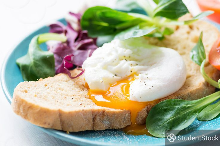 "StudentStock - ""Poached egg toast with green salad"" by Vladislav Nosick"