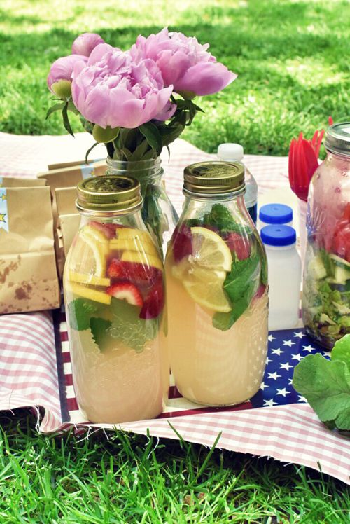 Lemonade with strawberries and basil; chips in individual paper bags; tomato-basil-mozzarella sandwiches