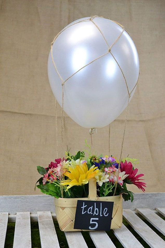 10 DIY Centerpieces. Do-able and not expensive.  Painted bottles and balloon basket cool