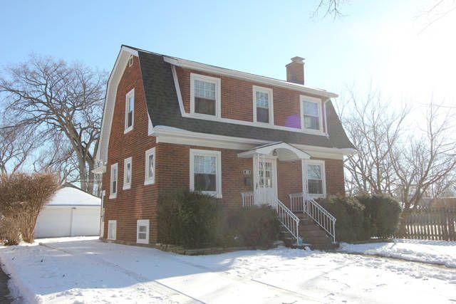 Brick Colonial House Wrap Around Porch