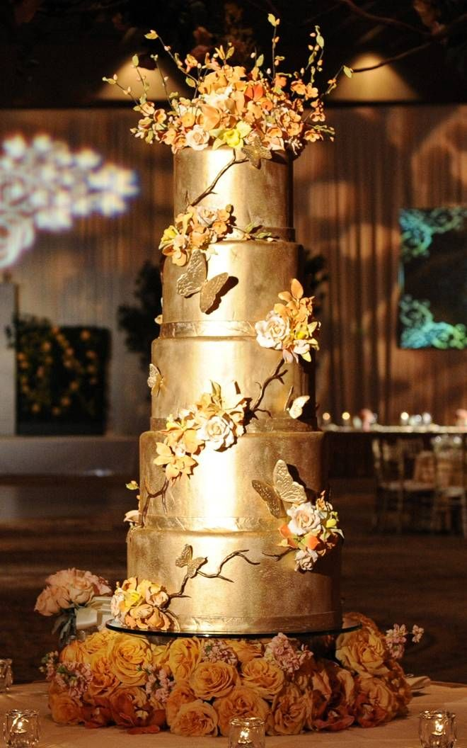 Metallic Wedding Cake -- would personally prefer a simpler version, but love the metallic gold.