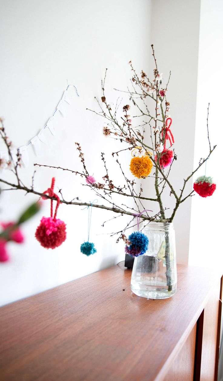 Pom Poms Kids Craft: hang them on spring branches, easy Easter craft