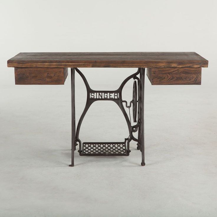Recycled wood and iron fuse together in the Industrial Loft Sewing Desk to create a fun and functional piece of furniture. Crafted exclusively from reclaimed materials this eclectic desk is modeled af