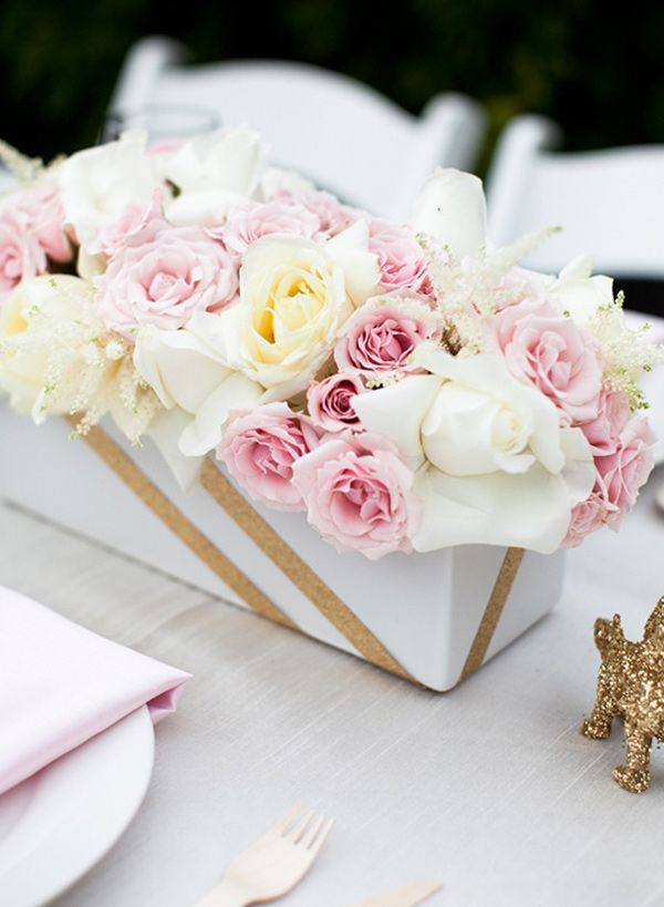 add a bit of sparkly tape, gold ribbon, or gold sparkly leaves to an arrangement