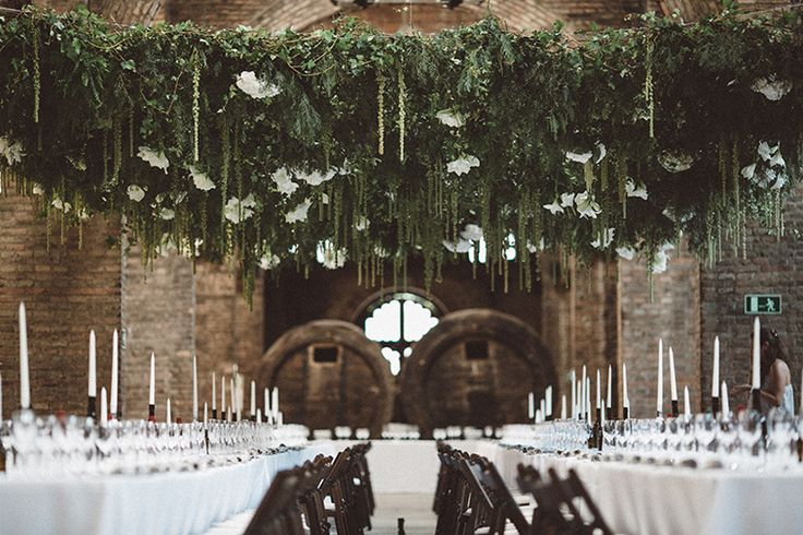The most stunning rehearsal dinner at a historical vineyard venue with underground wine cellars in Spain, Cavas de Codorniu. Photo by A Fist Full of Bolts   Planning & Design by Cherry on Top Events