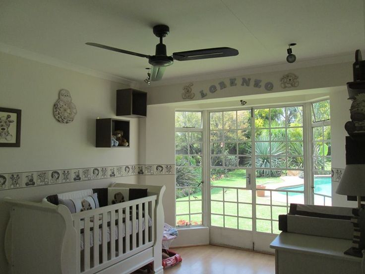 Stone scruffy jungle nursery - complimented with white washed baby furniture for an absolutely stunning classic look! www.facebook.com/borderboutique.co.za