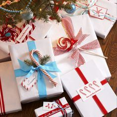 Candy Wrappers - Streamline gift-giving by wrapping all your presents in the same pristine white paper brightened with bold color. It's elegant, economical, and easy to customize with tree cuttings, tags, and tempting candies.