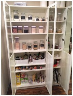 IKEA Hack- Billy Bookcase as Pantry Storage- has glass doors on top & solid on the bottom for the best of both worlds. Love this so much!