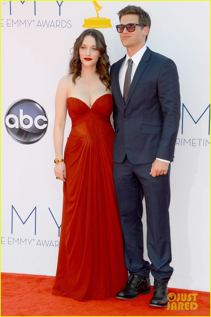 Kat Dennings and her boyfriend Nick Zano walk the red carpet together at the 2012 Emmy Awards