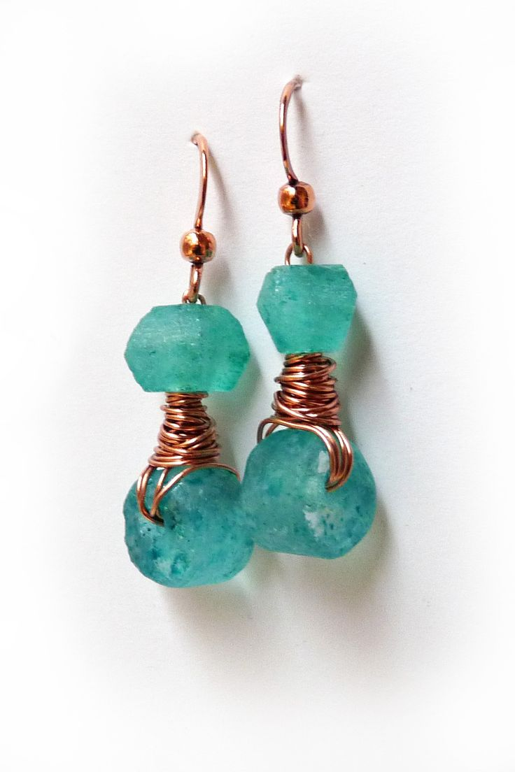 Rustic elegance. Colorful dangle earrings created from recycled bottle glass beads and copper wire wrapping. The recycled glass bead discs have a frosty matte finish around the edges and sparkling fla