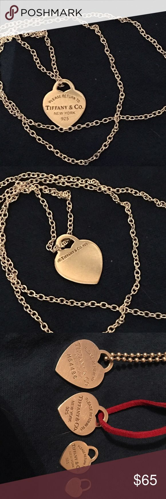 Medium Tiffany heart necklace This is the medium please return to Tiffany necklace. There are sizes in the photo. extra large, large, medium, and mini. This is the medium. I hung it in a 22 inch sterling silver chain. The price is the same with or without the chain. Awesome condition. Please see all of my amazing deals by clicking on my page. Tiffany & Co. Jewelry Necklaces