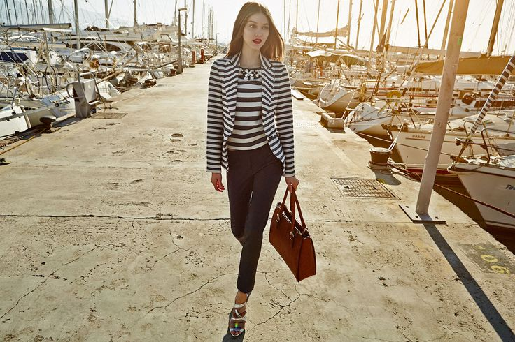 striped blazer with matching blouse paired with black trousers