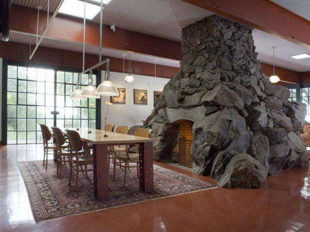 https://laurelberninteriors.com/wp-content/uploads/2016/12/14-22708-post/ugliest-stone-fireplace.jpeg