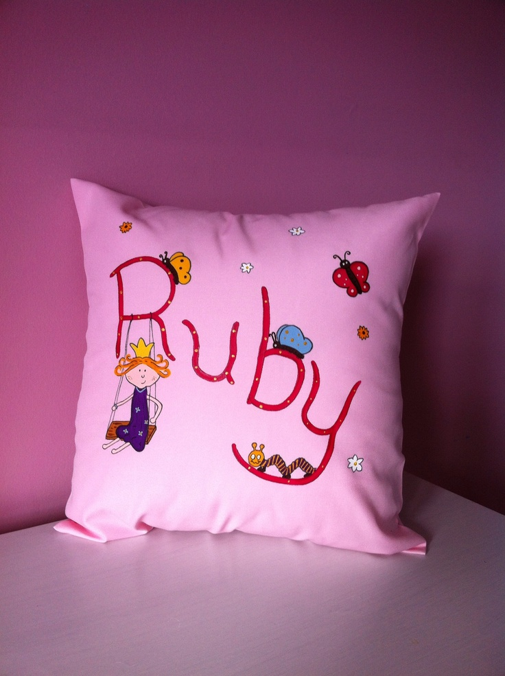 Ruby loves to cuddle up to her princess cushion when she goes to sleep.