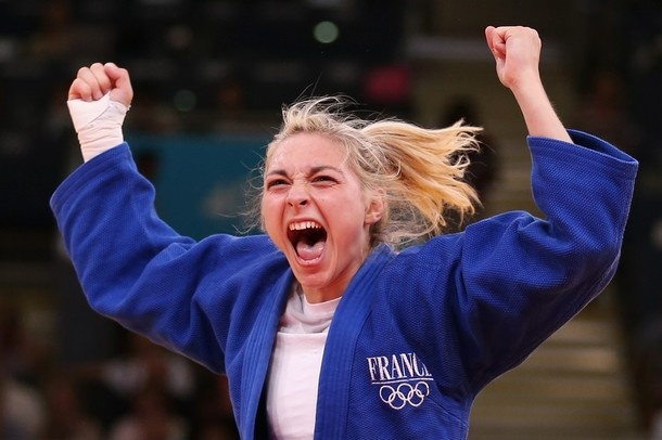 LONDON, ENGLAND - JULY 30:  Automne Pavia of France celebrates her bronze medal B over Hedvig Karakas of Hungary during the Women's -57 kg Judo on Day 3 of the London 2012 Olympic Games at ExCeL on July 30, 2012 in London, England.