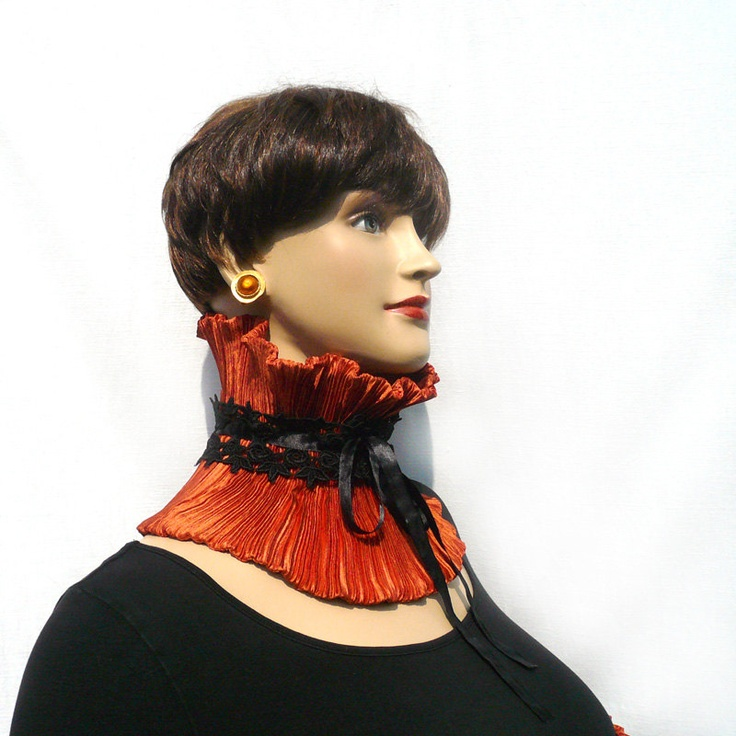 Rust collar with black lace and ribbon closure via Etsy.