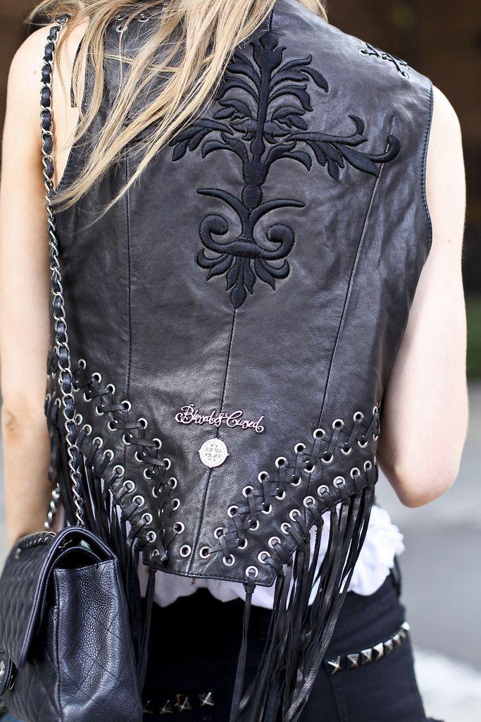 leather vest. fringe