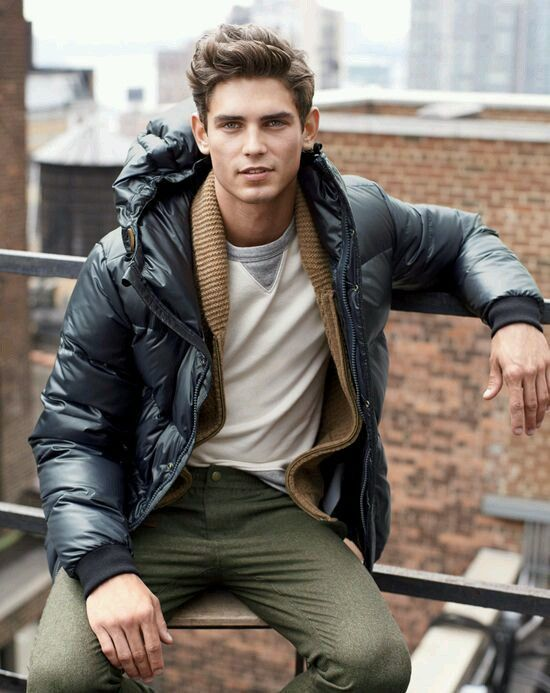 A navy parka and army green wool trousers will showcase your sartorial self.  Shop this look for $114:  http://lookastic.com/men/looks/grey-longsleeve-t-shirt-olive-dress-pants-navy-parka-brown-shawl-cardigan/5989  — Grey Longsleeve T-Shirt  — Olive Wool Dress Pants  — Navy Parka  — Brown Shawl Cardigan